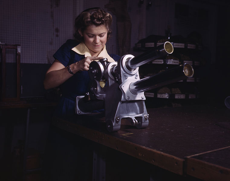 761px-A_young_woman_employee_of_North_American_Aviation,_Incorporated,_working_over_the_landing_gear_mechanism_of_a_P-51_fighter_plane,_Inglewood,_Calif